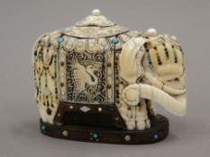 A 19th century Chinese carved ivory model of an elephant, decorated with turquoise,