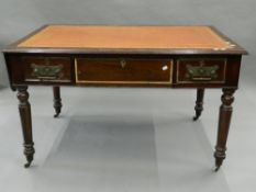 A Victorian walnut writing table. 125 cm wide.