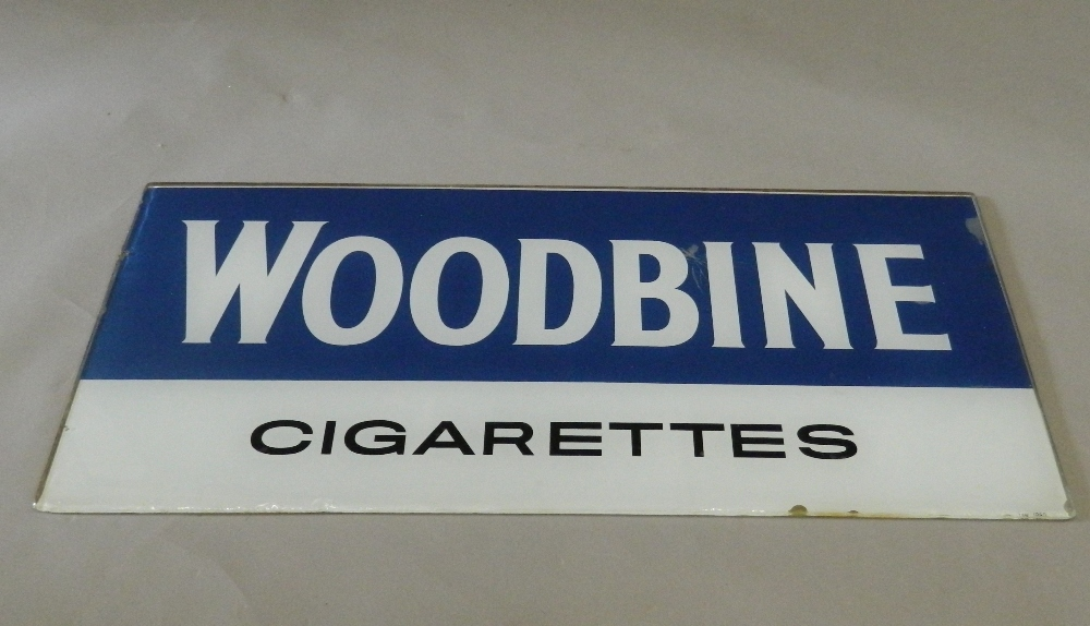 A vintage Woodbines Cigarette glass advertising sign. 92 cm wide.