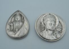 Two Chinese pendants. The largest 4.5 cm diameter.