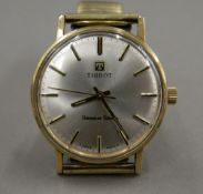 A vintage Tissot 9 ct gold Seastar Seven watch, recently serviced. 3.5 cm wide.