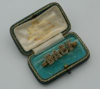 A Victorian yellow metal and pearl 'baby' brooch. 3.5 cm wide (2.