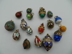 A collection of 17 enamelled Russian egg pendants, the majority in 925 silver.
