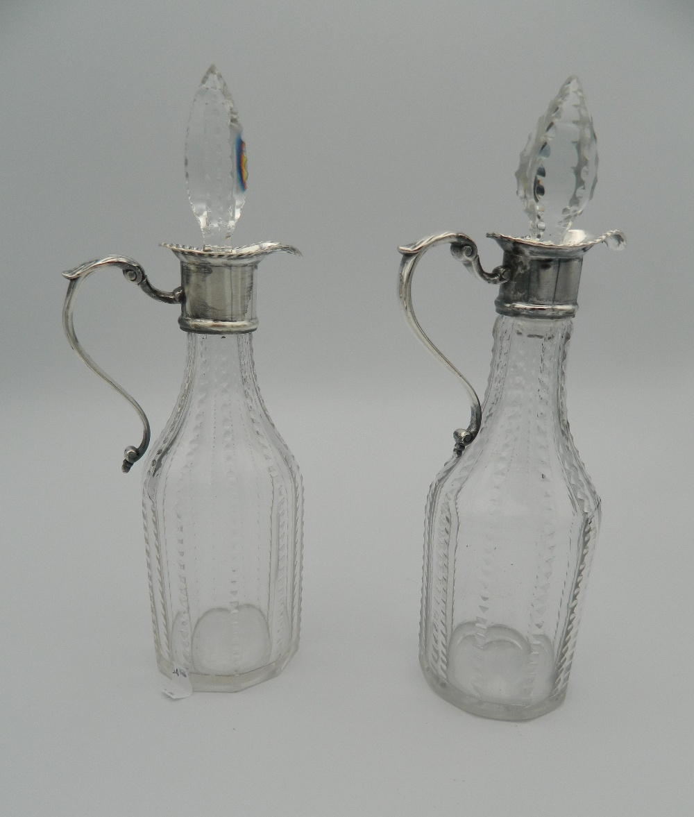 Lot 10 - A George III silver and glass two bottle cruet,