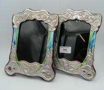 A pair of Art Nouveau style sterling silver photo frames. 21 cm high.