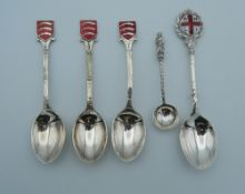 Four silver and enamel spoons (60 grammes), together with another.
