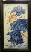 A Chinese porcelain plaque with floral decoration and calligraphy, framed.