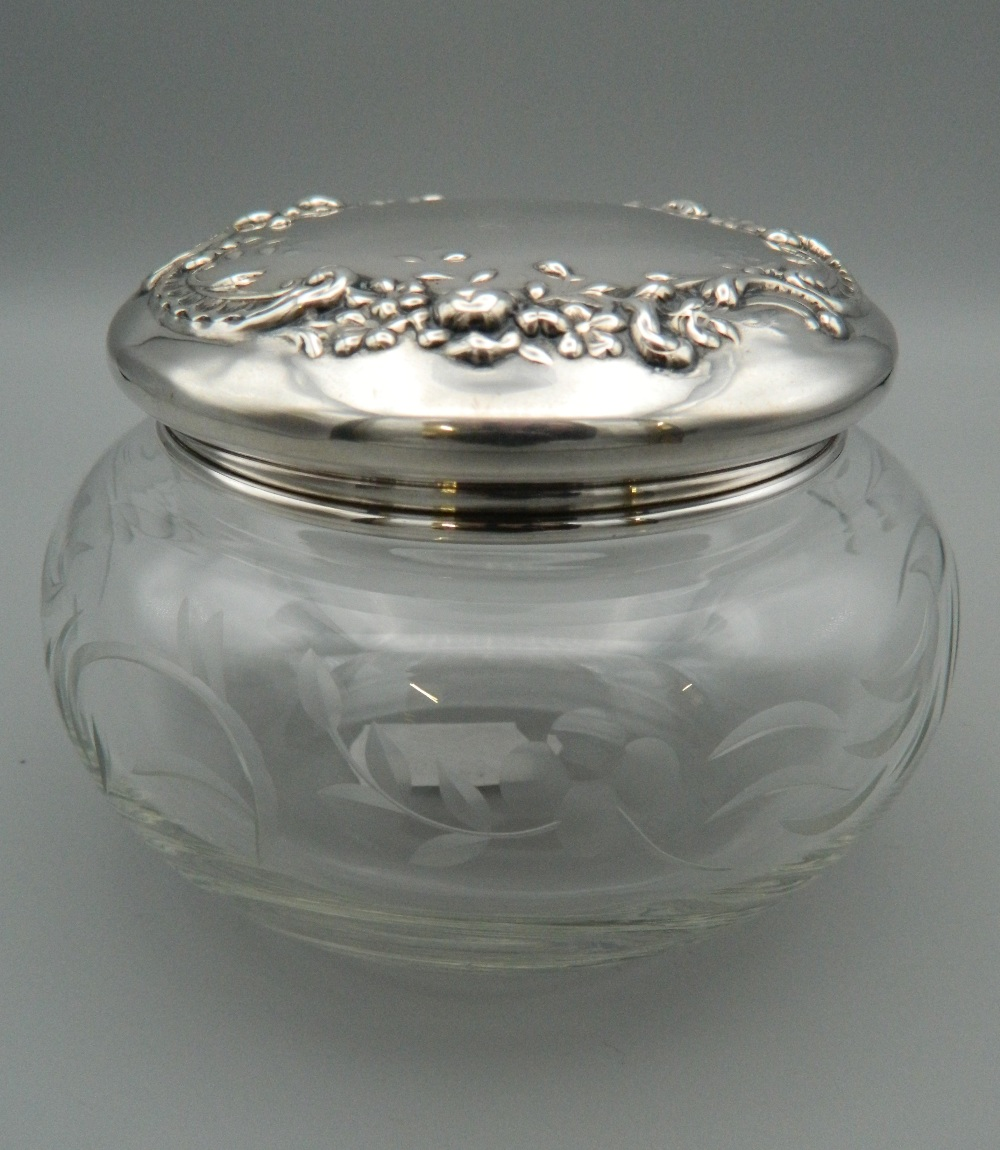 Lot 24 - A Gorham and Co vintage sterling silver topped cut glass powder bowl and cover. 11 cm diameter.