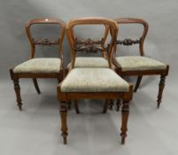 A set of four Victorian rosewood balloon back dining chairs. 46 cm wide.