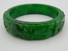 An apple green jade bangle. 7.5 cm diameter.