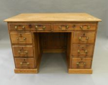 A Victorian pitch pine desk. 113 cm wide.