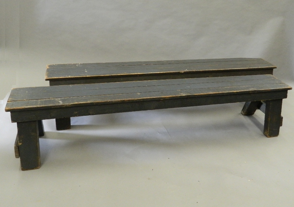 A pair of painted pine benches. 183 cm long.