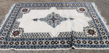 A Moroccan white ground rug. 183 cm wide.