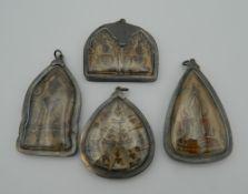 Four Asian icon pendants. The largest 7.5 cm high.