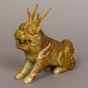 A Chinese jade carving of a Qilin, typically modelled. 15.5 cm high.