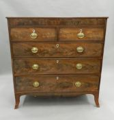 A 19th century cross banded mahogany chest of drawers. 114 cm wide.