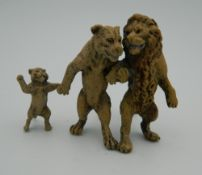 A cold painted bronze model of a lion group. 6 cm high.