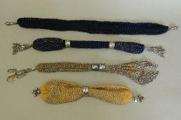 Four vintage cut steel mounted Misers purses. Longest 45.5 cm long.