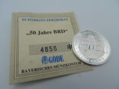 A German silver coin. 3 cm diameter.