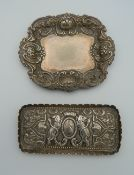 Two silver pin dishes.