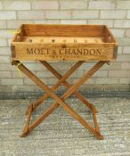 A wooden butlers tray on stand.