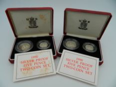 Two cased pairs of silver five pence pieces