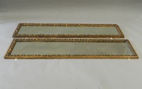 A pair of full length gilt framed dressing mirrors. 160 cm high.