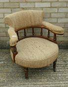 A Victorian walnut frame tub open armchair. 67 cm wide.