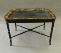 A Victorian papier mache tray on later base. 72 cm long.
