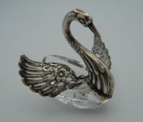 A silver and glass salt formed as a swan. 7 cm high.