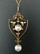 An Edwardian 9 ct gold and pearl Art Nouveau pendant on a modern 9 ct gold chain.