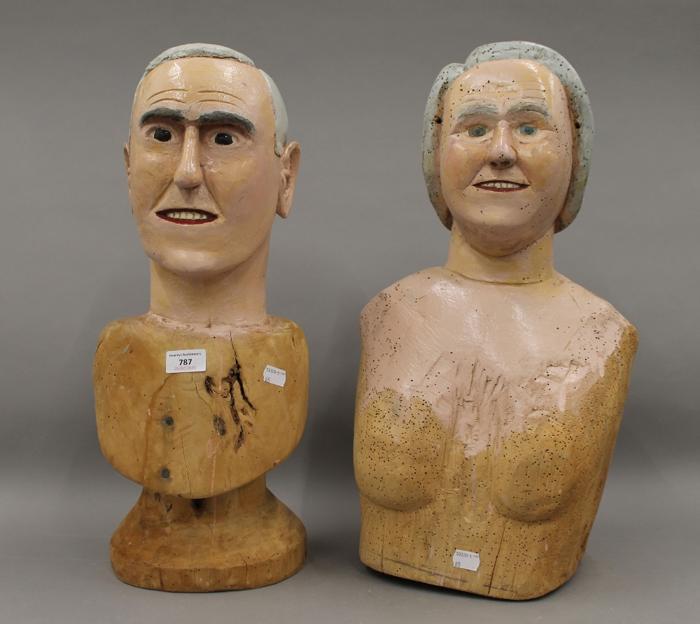 Two Folk Art painted carved wooden busts, one male, the other female. The male 52.5 cm high.