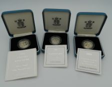 Three £1 silver proof coins,