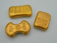 Three Chinese golden paperweights