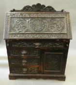 A Victorian carved oak bureau. 92 cm wide.