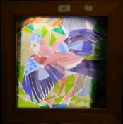 A stained glass panel depicting a bird, framed. 39.5 cm wide.