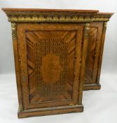 A pair of 19th century ormolu mounted parquetry pier cabinets. Each 95 cm wide, 131 cm high.