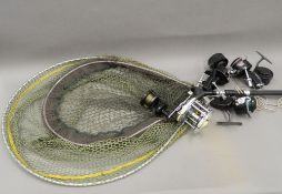 A 14'' trout landing net and handle, and an 18'' carp landing net,