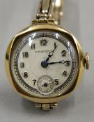 A vintage ladies 9 ct gold Eswang Swiss made watch on a 9 ct gold on silver bracelet. 2.