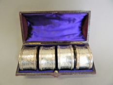 A cased of four silver napkin rings. Each 4.5 cm diameter (3.4 troy ounces).