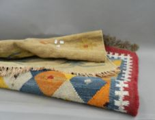 Two wool rugs. The smallest approximately 128 cm long.