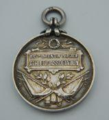 A 1917 silver military medallion.