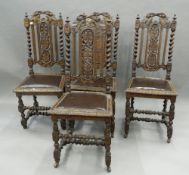 A set of four 19th century carved oak dining chairs. 44 cm wide.