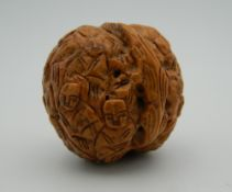 A Chinese carved walnut. 3.5 cm high.