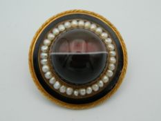 A Victorian unmarked gold, agate and pearl brooch, of target form,