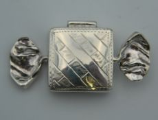 A silver sweet form pill box. 5 cm wide.