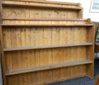 Two large modern pine wall racks. The largest 183 cm wide.