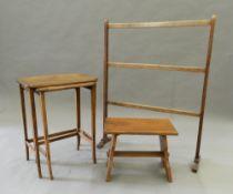 A mahogany towel rail and two oak side tables. Towel rail 76 cm wide.