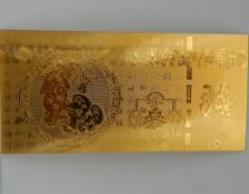 A Chinese gold leaf panel. 4.5 cm wide.