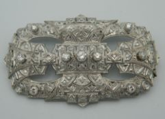 An Art Deco style platinum and diamond set brooch. 7 cm wide (21.